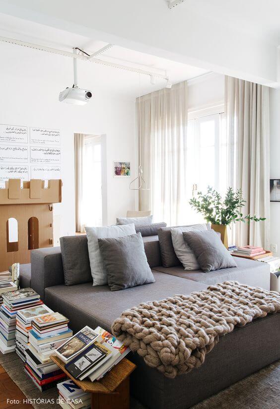 Sala de Estar com maxi tricot e almofadas para o inverno