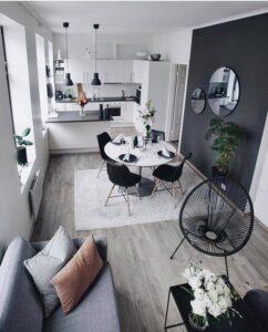 Sala com parede na cor preta